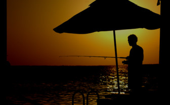 Picture of a fisherman at sunset on Little Palm Island