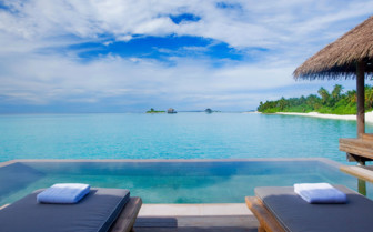 A Pool Overlooking The Sea In The Maldives