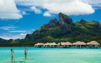 Paddle boarding on Bora Bora Island in French Polyensia