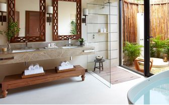 An image of an Oceanfront Bathroom at The Viceroy Riviera Maya