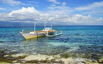 Boat by the shore, Apo Island