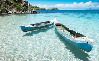 Boats in crystal clear water, Indonesia