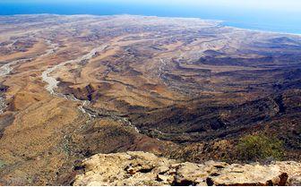 mountain view over coastline, Oman