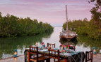 Picture of dining by the water at Chole Mijini, luxury hotel in Africa