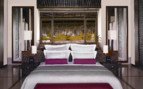 Luxury bedroom at Reethi Rah, luxury hotel in the Maldives
