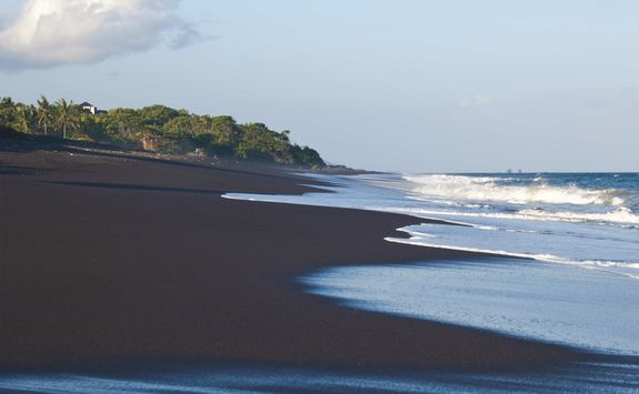 Black sand beach of East Bali
