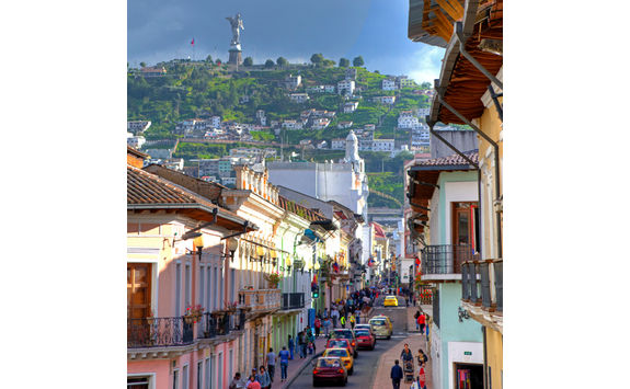 quito colourful street and mountain