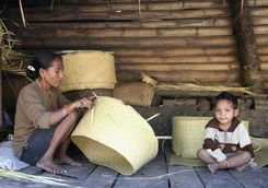 Woman weaving baskets