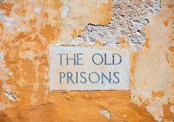 old prison sign