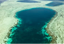 Aerial view of blue hole and reef