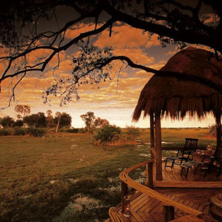 The terrace at night at Mombo Camp, luxury camp in Botswana