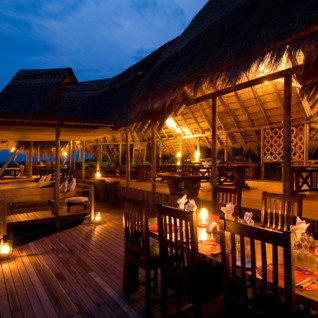 Dining at the camp verandah at Selinda Camp, luxury camp in Botswana