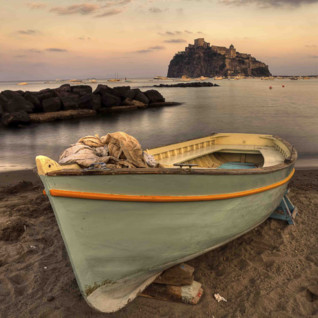 Boat docked on beach