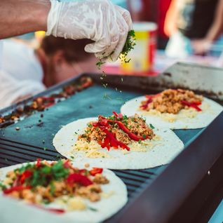photo of a fajita being made on the street