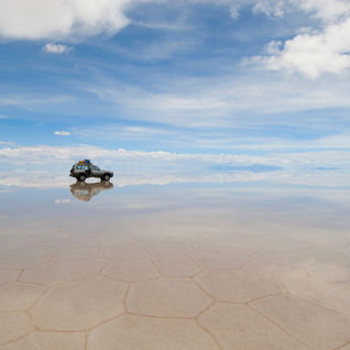 jeep driving over salt flats