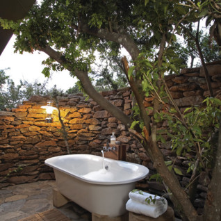 Outside bath at Singita Faru Faru Lodge, luxury lodge in Tanzania