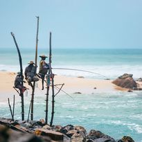 fishermen-on-stilts-in-ocean