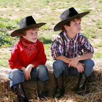 Young boys dressed as cowboys