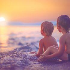 boys on a beach at sunset