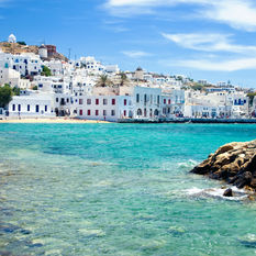 beach and city in Mykonos