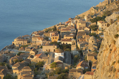 Aerial view of the Peloponnese coast line and rooftops of buildings