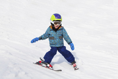 child skiing austria