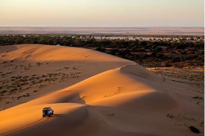Driving sand dune desert safari at sunset, Dubai