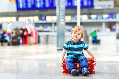a small boy at an airport