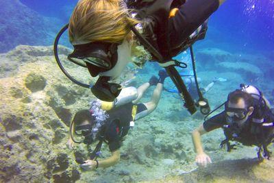 a girl scuba diving