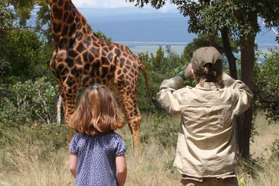 children animal watching on safari