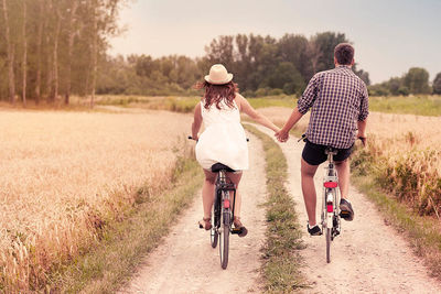 couple on bikes sabbatical planning