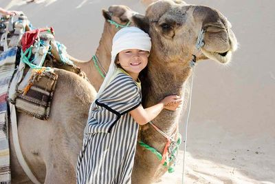 Camel with child in Jordan