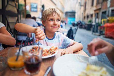 Concierge Boy Eating Pizza