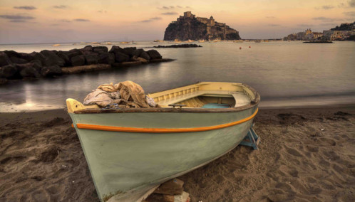 Boat docked on beach