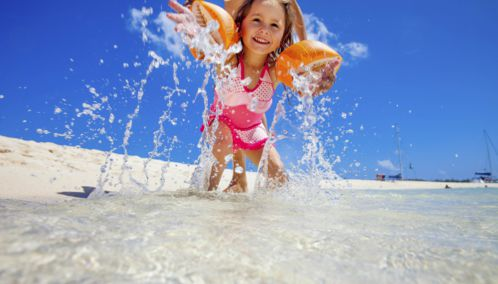 Child Playing in the Sea, Mauritus