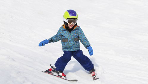 Little Boy learning to ski in Lech, Austria
