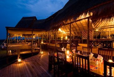Dining at the camp verandah at Selinda Camp, luxury camp in Botswana