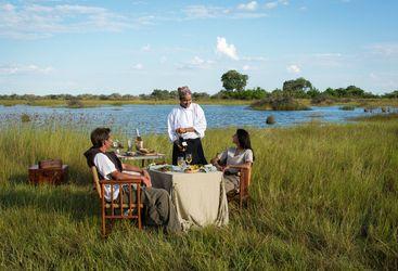 Private dining at Vumbura Plains Camp, luxury camp in Botswana