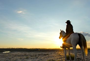Horseback riding at Camp Kalahari, luxury camp in Botswana, Africa
