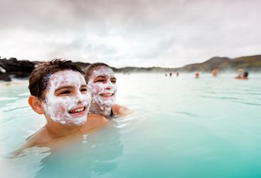Children enjoying the Blue Lagoon, Iceland