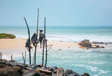 fishermen-on-stilts-in-ocean