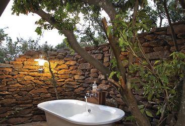 Outside bath at Singita Faru Faru Lodge, luxury lodge in Tanzania