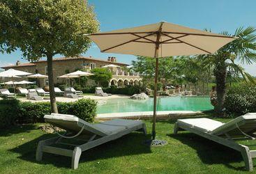 Pool area at Borgo Santo Pietro, luxury hotel in Italy