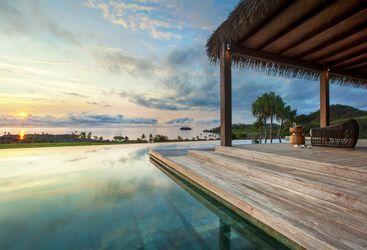 Sunset at Six Senses Fiji pool