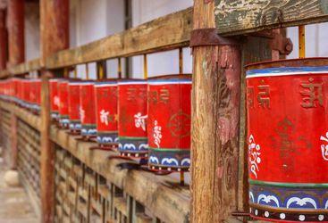 Red prayer wheels, Bhutan