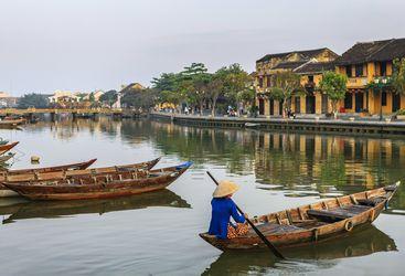 Vietnamese woman on boat in Hoi An