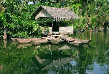 Riverside hut on the Mekong Delta