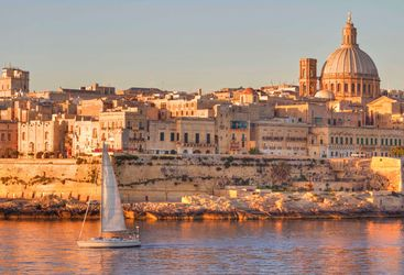 Valletta boat at sunset