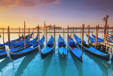 gondolas in venice at sunrise