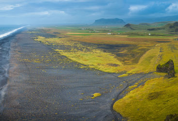 Aerial panorama over black beach